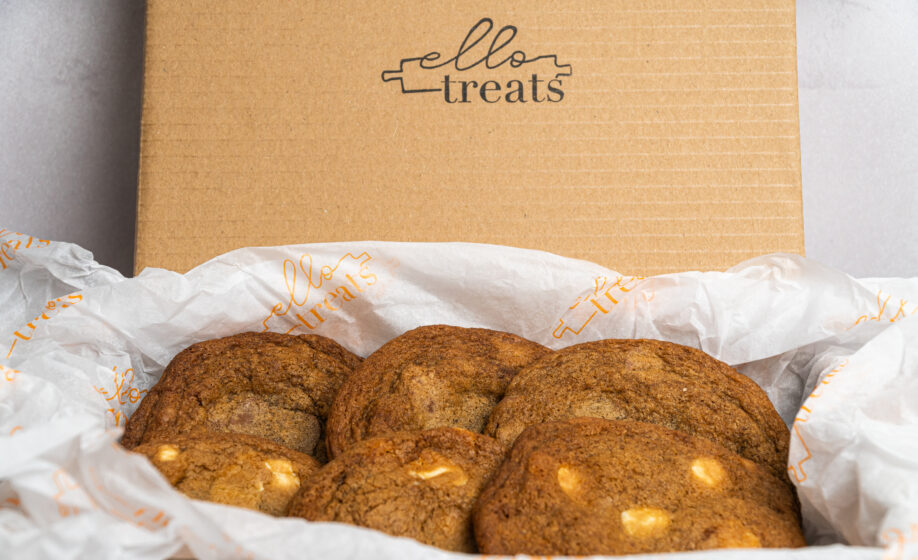 6 classic cookies with white chocolate pieces showing, in a cardbox box showing the ello treats logo