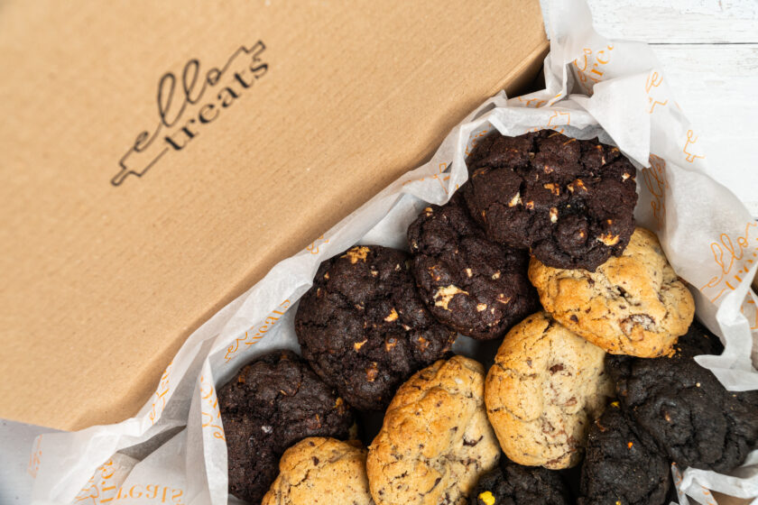 photo of 12 chunky nyc cookies taken at a high angle to show the box and logo