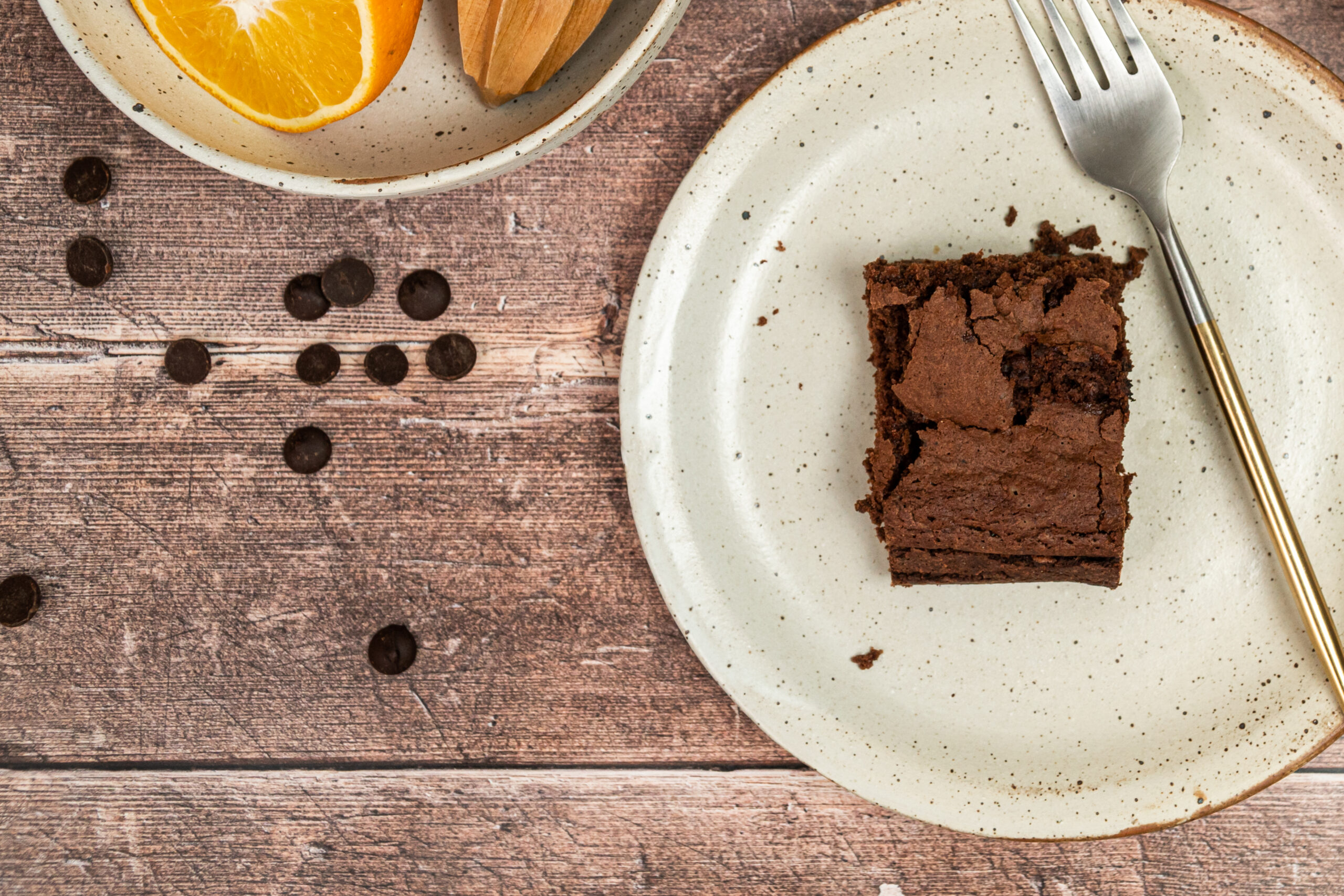 milk chocolate brownie on a plate with a fork