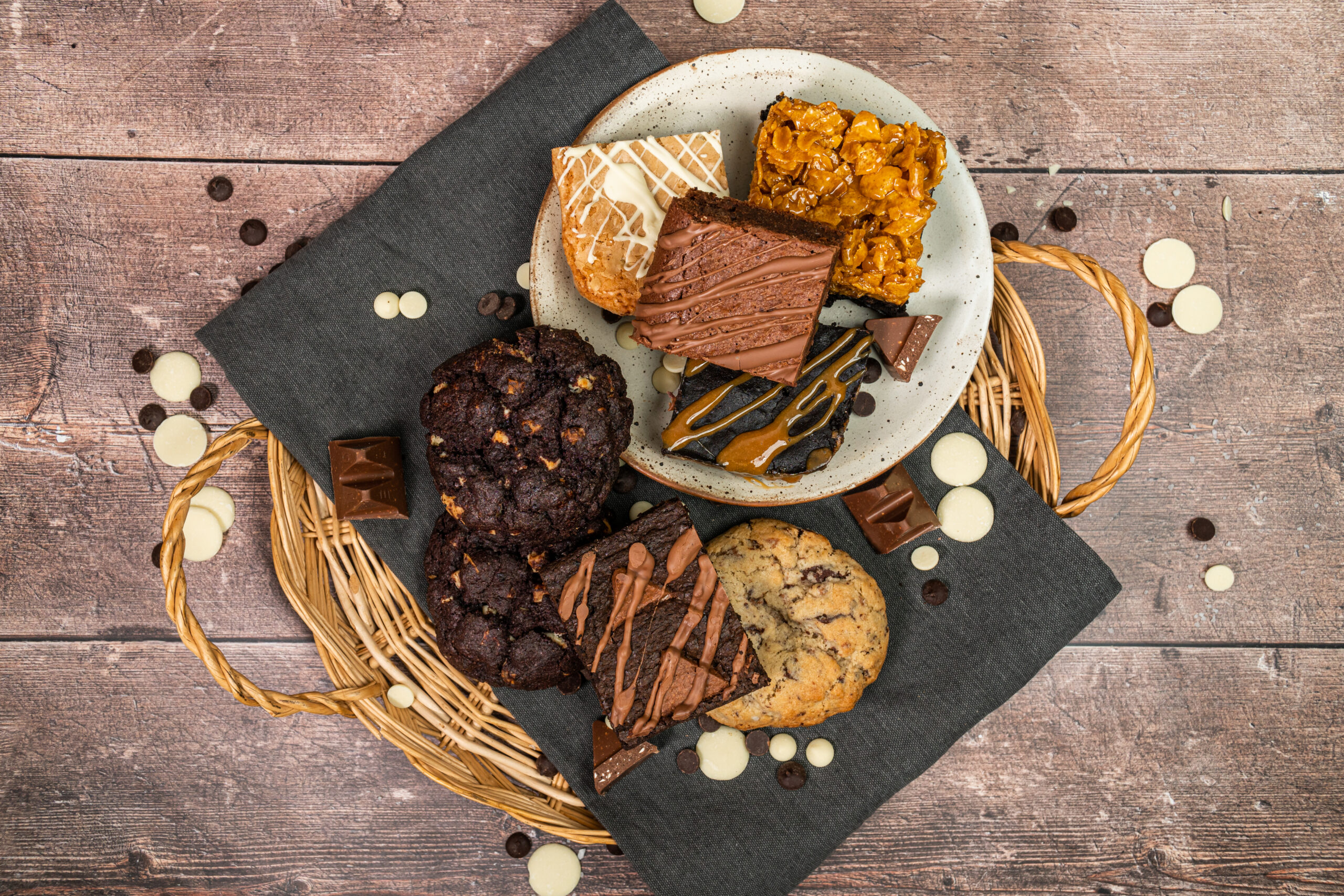 collections of treats in a basket, including various cookies and brownies