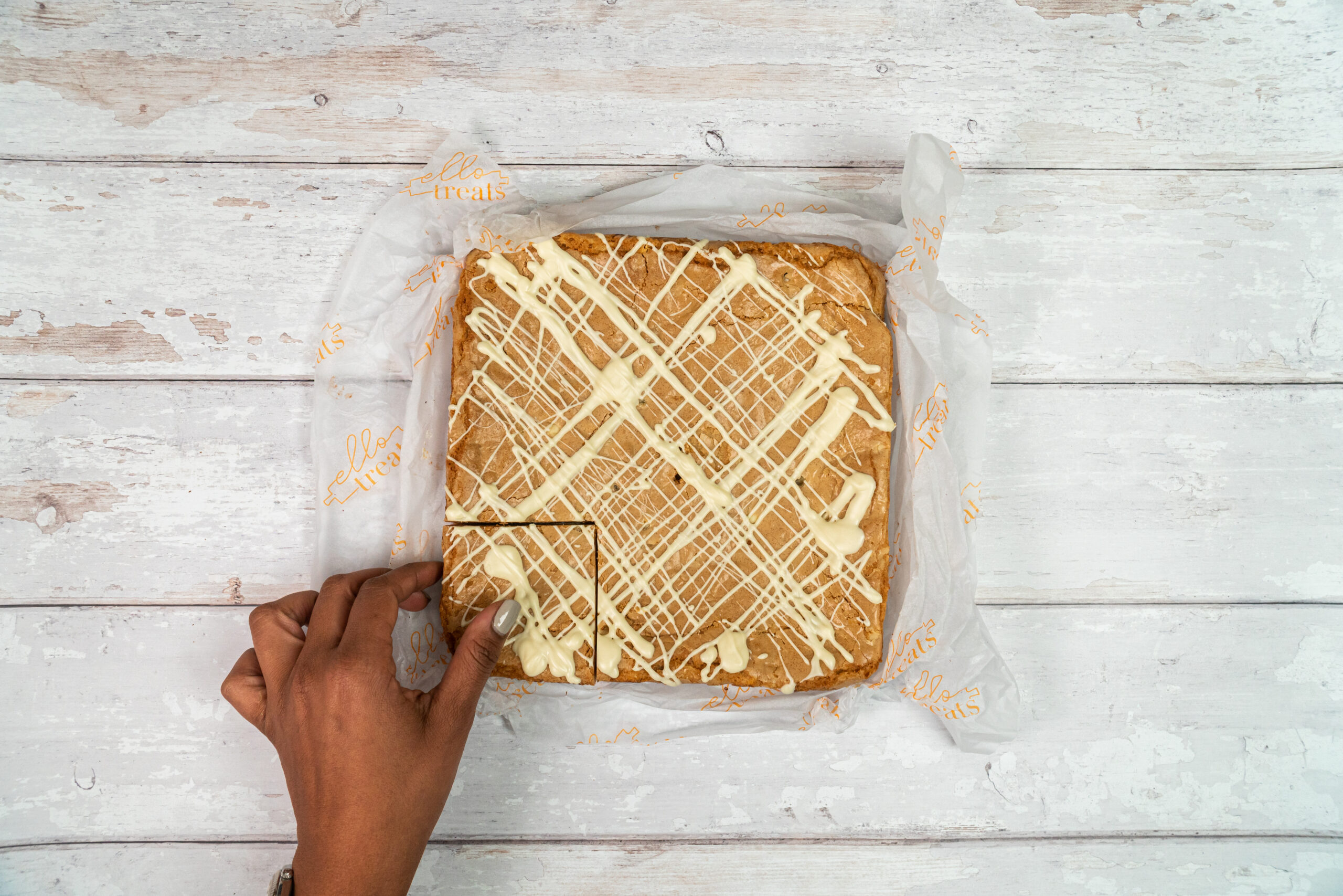 slab of white chocolate blondie, covered in a white chocolate drizzle