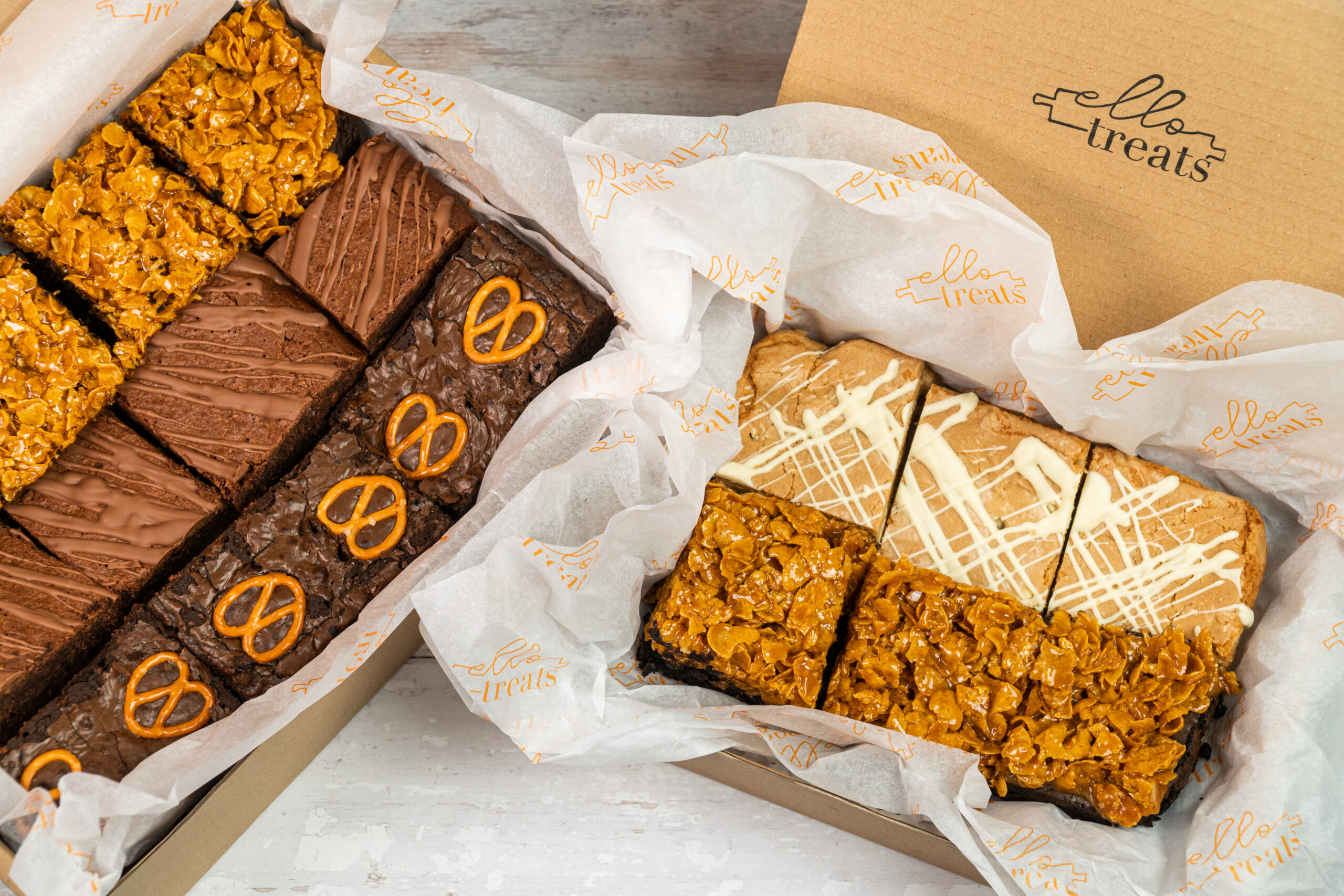 2 boxes of loaded brownie, taken at a high level to show the boxes and their tissue paper