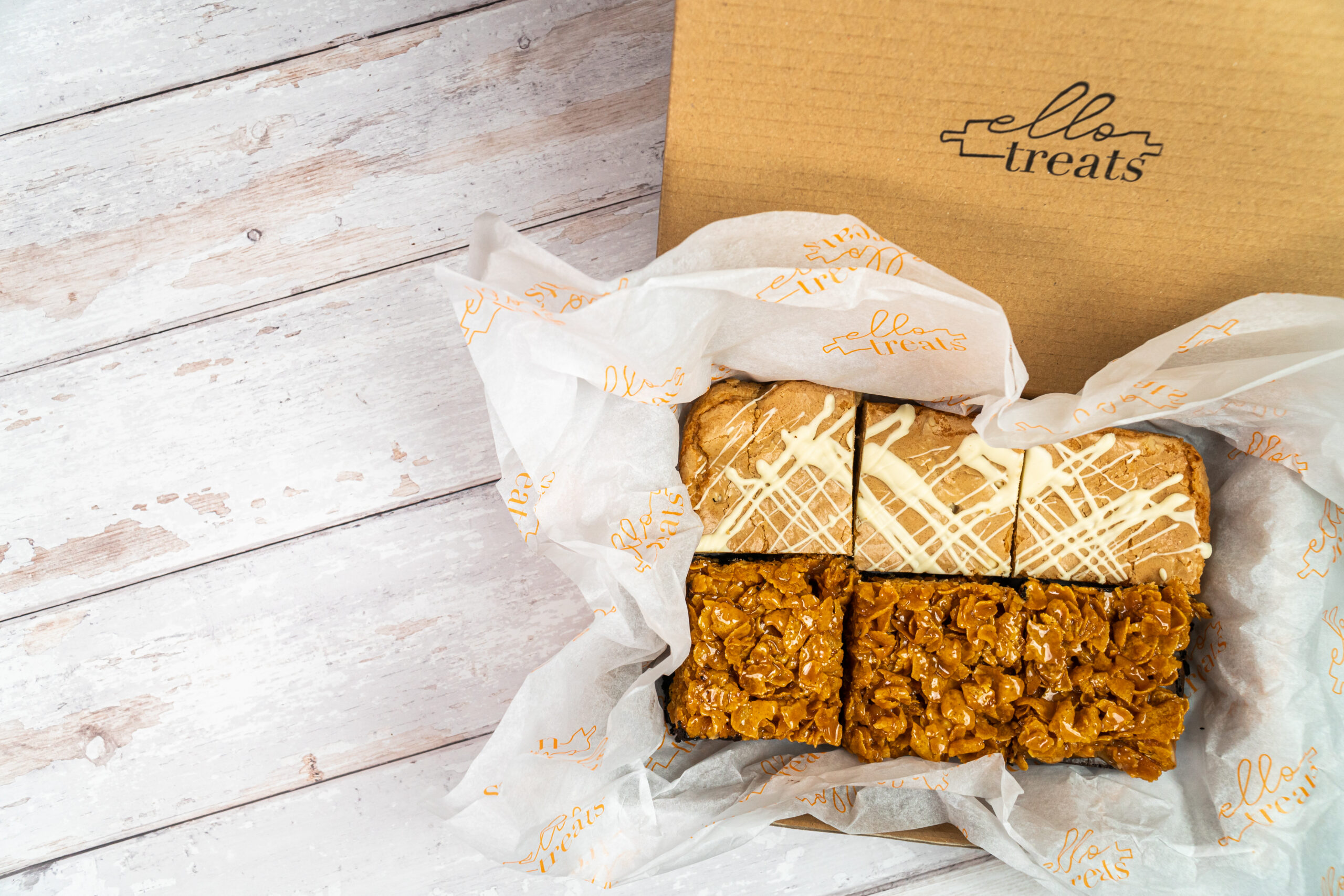 box of 6 loaded brownies with overflowing tissue paper